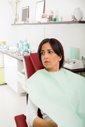 Woman anxious in dental chair at SmileCOS Dentistry in Colorado Springs, CO
